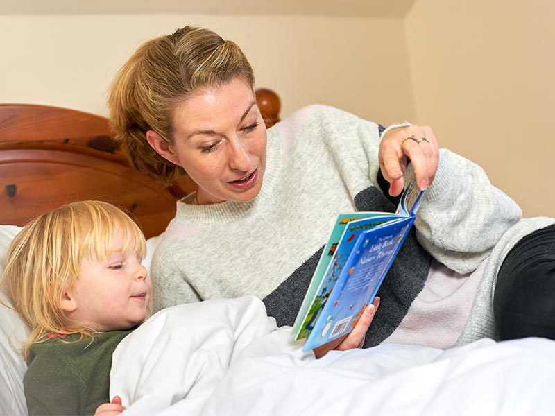 Karen Taylor with her child reading